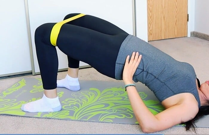 the bridge exercise with resistance band